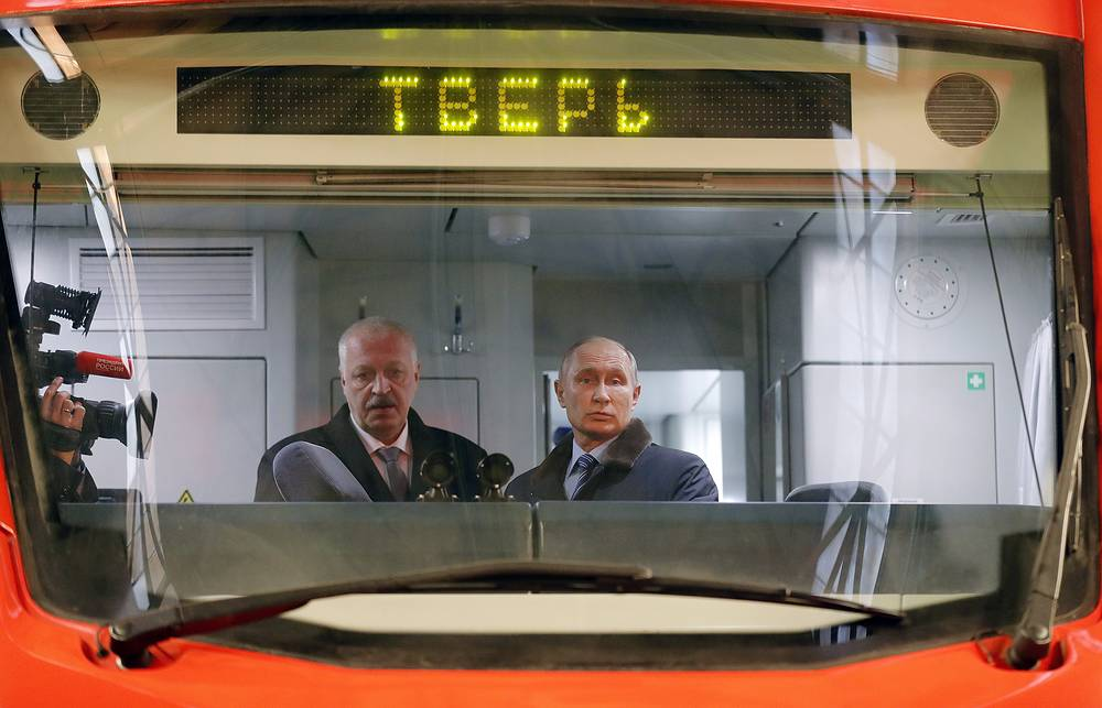The general director of TVZ Tver Carriage Works, Andrei Solovei and Russia's president Vladimir Putin in the cab of an Ivolga electric multiple unit train at TVZ factory, a major Russian manufacturer of rail coaches, Tver, Russia, January 10