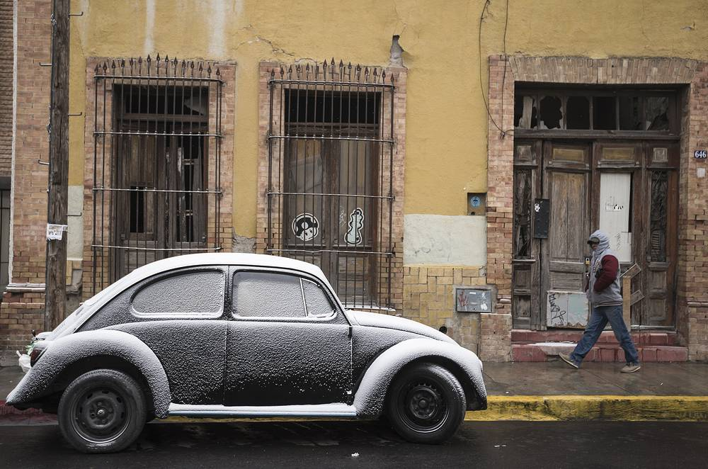 View of a car covered with snow due to the cold weather, in a street of Saltillo, Coahuila state, Mexico, January 17