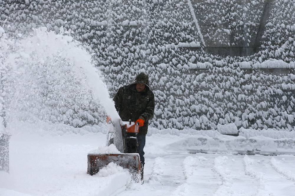 A worker clearing snow in central Moscow