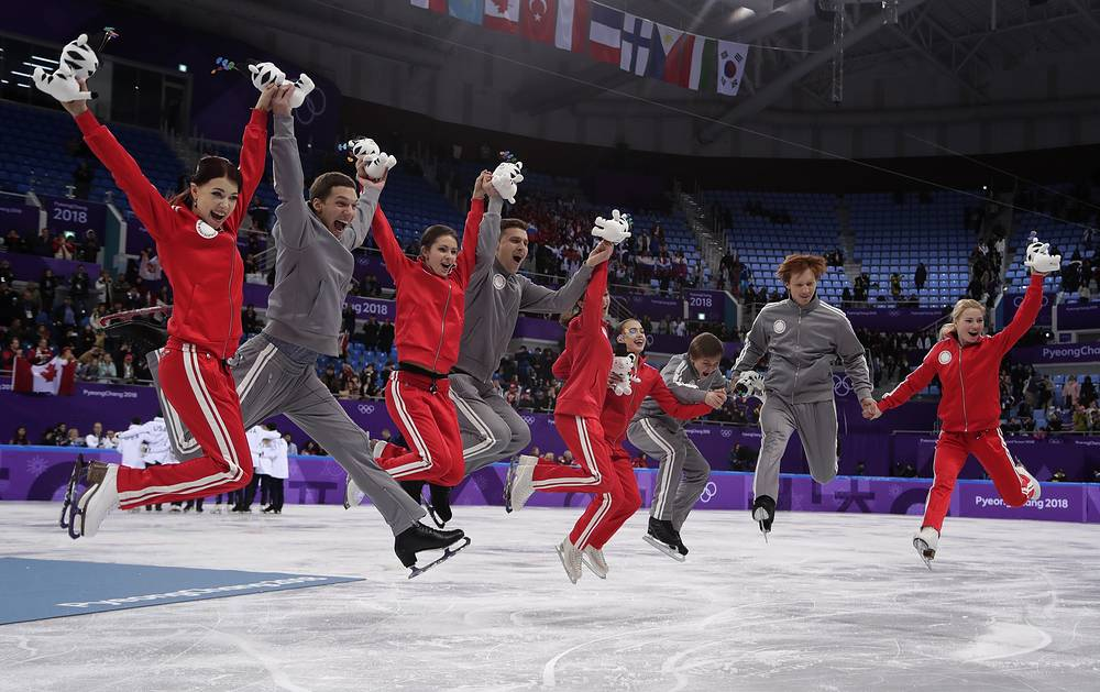 Olympic Athletes of Russia celebrate on the ice after their second place finish in the figure skating team event in the Gangneung Ice Arena at the 2018 Winter Olympics