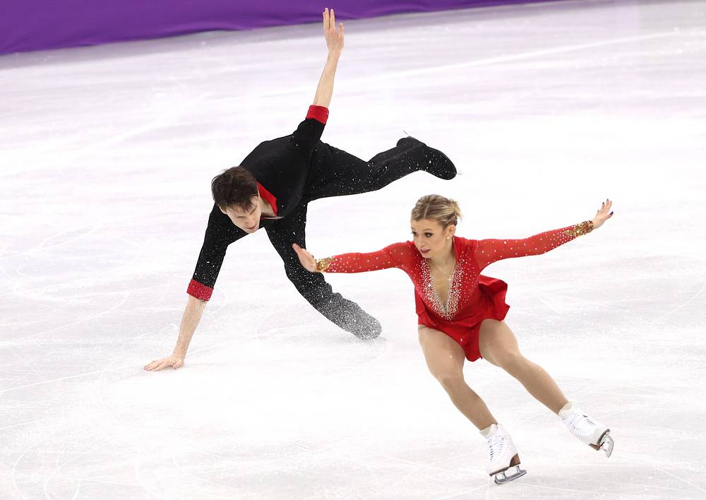Canada's Kirsten Moore-Towers and Michael Marinaro perform their short program during a figure skating event