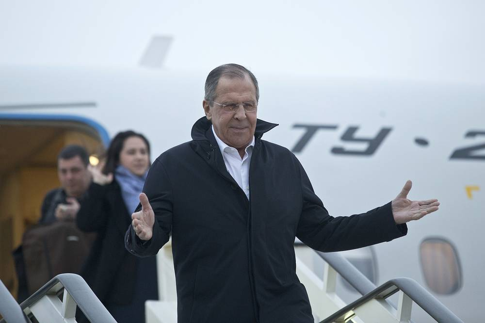 Russian foreign minister Sergey Lavrov gestures as he exits a plane upon his arrival in Belgrade, Serbia, February 21