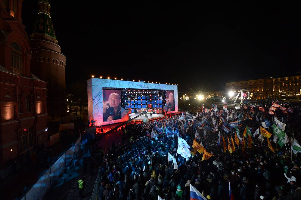 """Russian President Vladimir Putin talks to the crowd during a concert rally dubbed """"Russia. Sevastopol. Crimea"""", marking the 4th anniversary of Crimea's reunification with Russia in Manege Square, Moscow, Russia, March 18"""