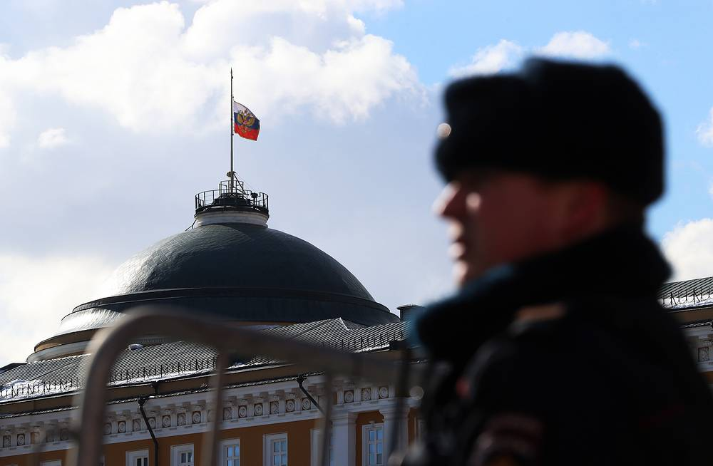 The Russian national flag flying at half-mast over the Senate Building of the Moscow Kremlin on the day of mourning in Russia