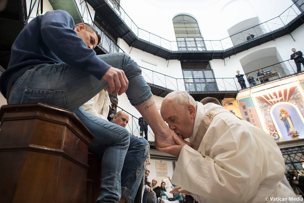Pope Francis washes the feet of inmates during his visit to the Regina Coeli detention center in Rome, Italy, March 29