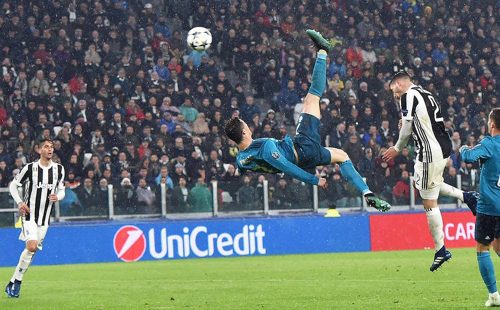 Real Madrid's Cristiano Ronaldo scores a spectacular 2-0 goal during the UEFA Champions League quarter final first leg soccer match between Juventus FC vs Real Madrid CF at Allianz stadium in Turin, Italy, April 3
