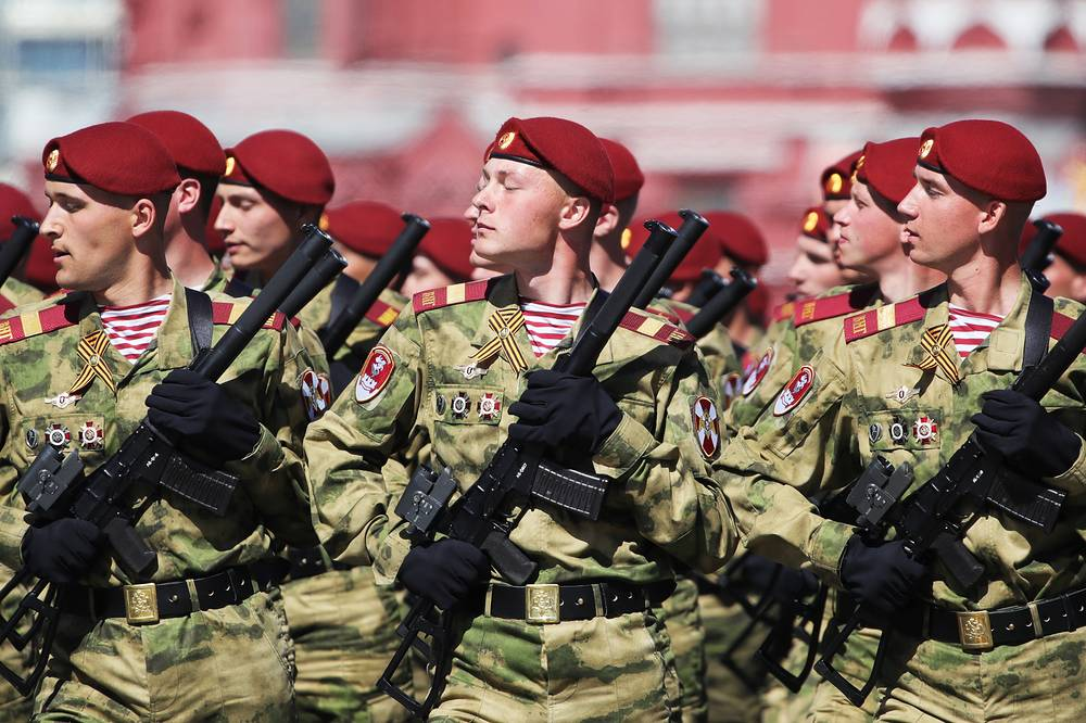 Servicemen march in formation during a Victory Day military parade