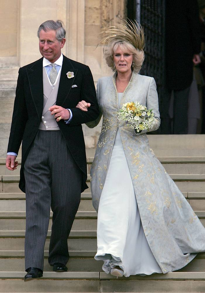 Britain's Prince Charles and Camilla Duchess of Cornwall leave St George's Chapel in Windsor, England following the church blessing of their civil wedding ceremony, April 9, 2005