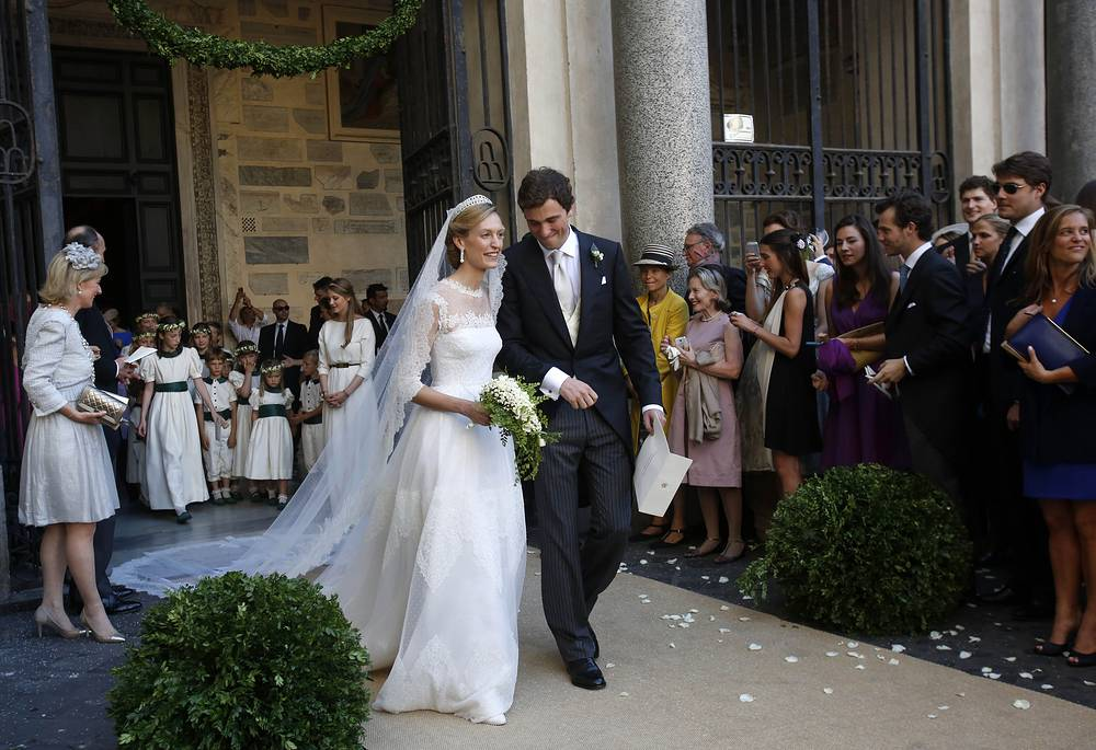 Belgium's Prince Amedeo and Elisabetta Maria Rosboch von Wolkenstein leave at the end of their wedding at St. Mary in Trastevere Basilica in Rome, July 5, 2014