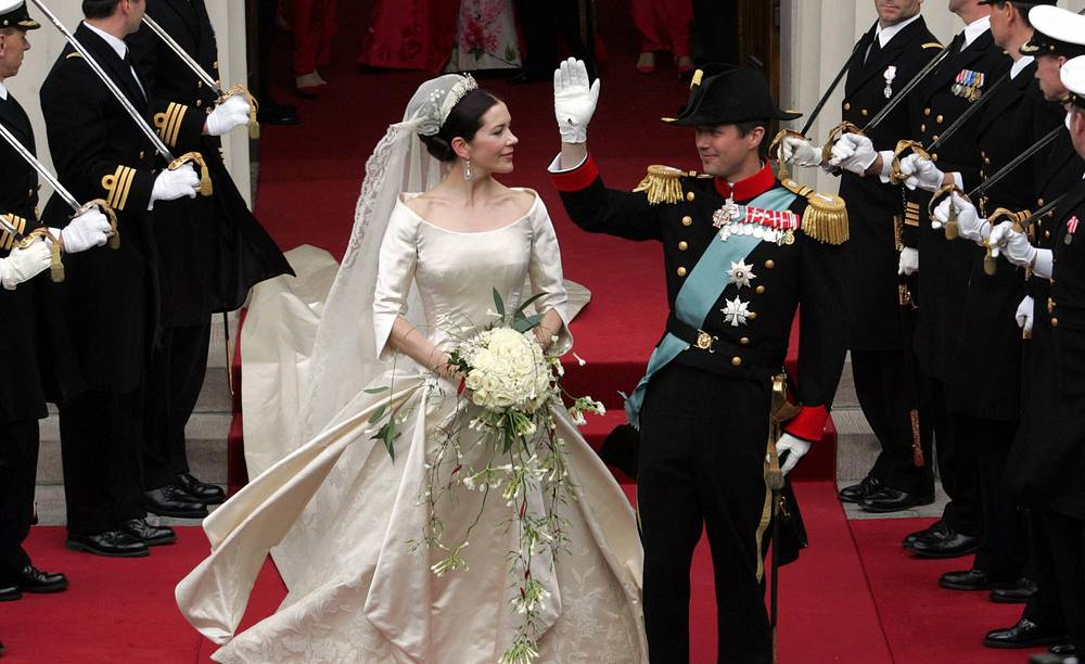Denmark's Crown Prince Frederik and Crown Princess Mary, leave Our Lady's Church following their wedding ceremony in Copenhagen, May 14, 2004
