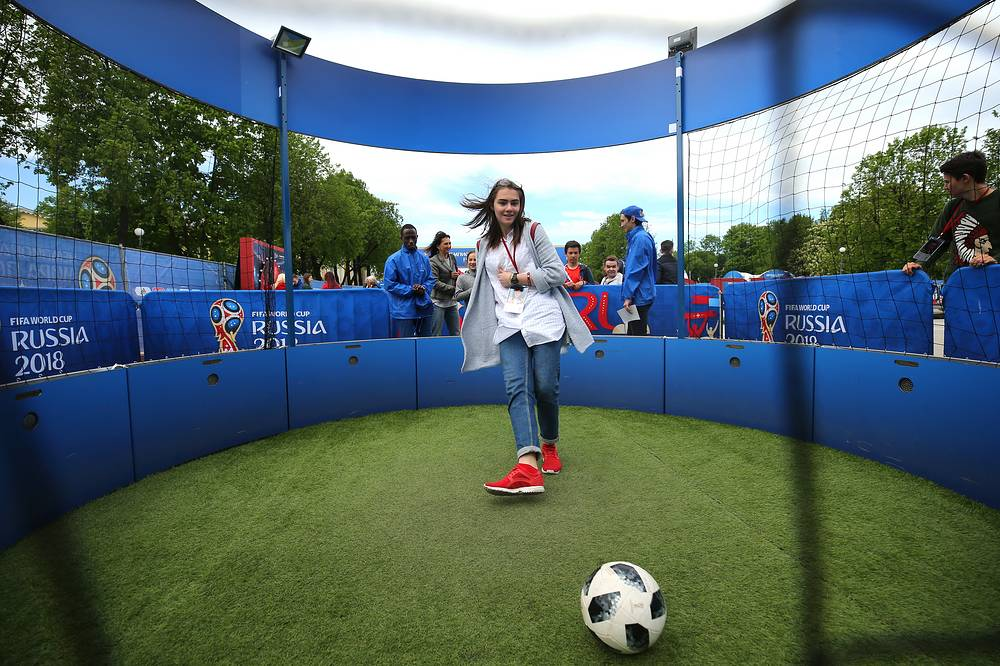 A girl kicking a ball at the opening of the 2018 FIFA World Cup Football Park in St. Petersburg