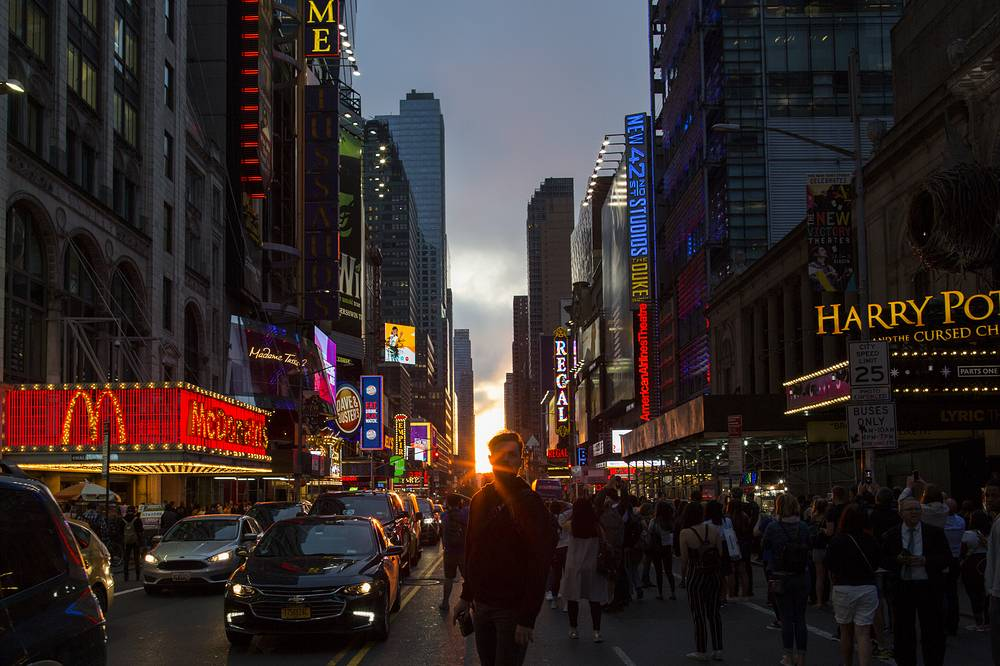 People take a look at the phenomenon known as Manhattanhenge on 42nd Street in New York City, May 30. Manhattanhenge, or the Manhattan Solstice, occurs twice a year when the sun is aligned with the east-west streets of the main street grid of Manhattan