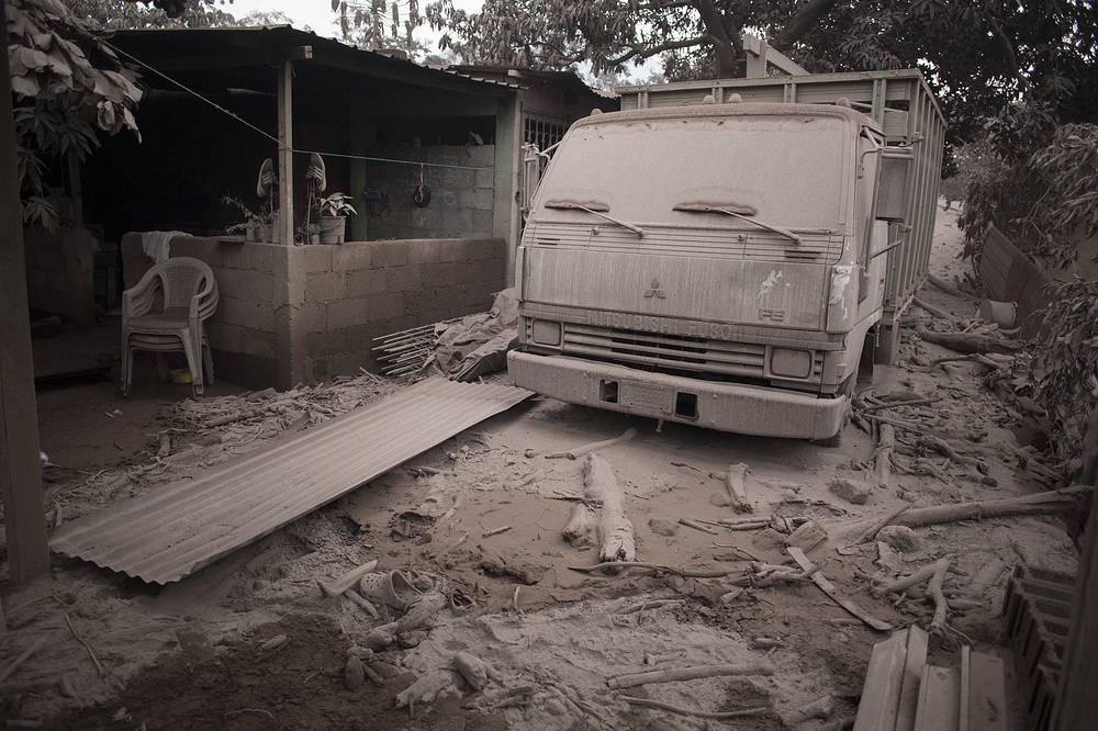 A truck is covered in volcanic ash spewed by Volcan de Fuego