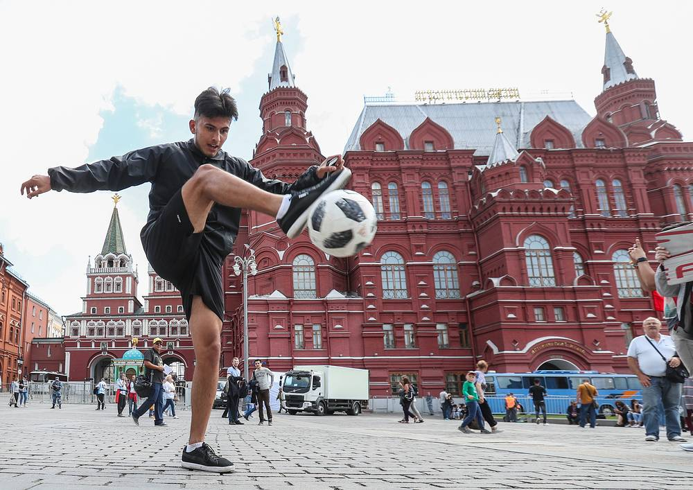 A young man kicks Telstar 18, the official match ball of the 2018 FIFA World Cup in Russia, in Moscow