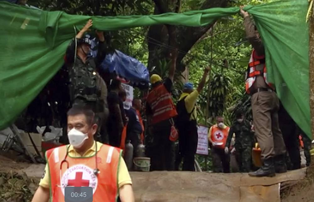 Emergency workers carry a stretcher with one of the rescued boys to be transported by ambulance to a hospital, in Mae Sai, Thailand