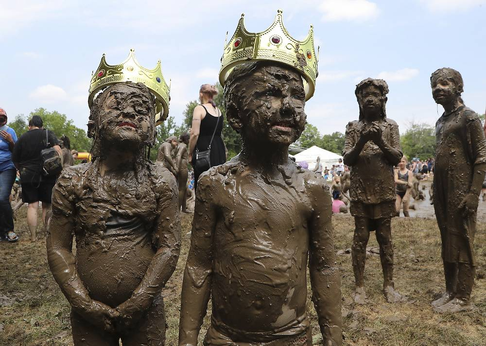Kids pose after being crowned Mud Day Queen and King during Mud Day at the Nankin Mills Park in Westland, July 10
