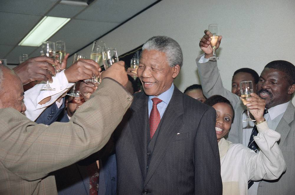 Nelson Mandela toasts his Nobel Peace Prize with members of his staff at the ANC headquarters during a celebration in Johannesburg, South Africa, 1993