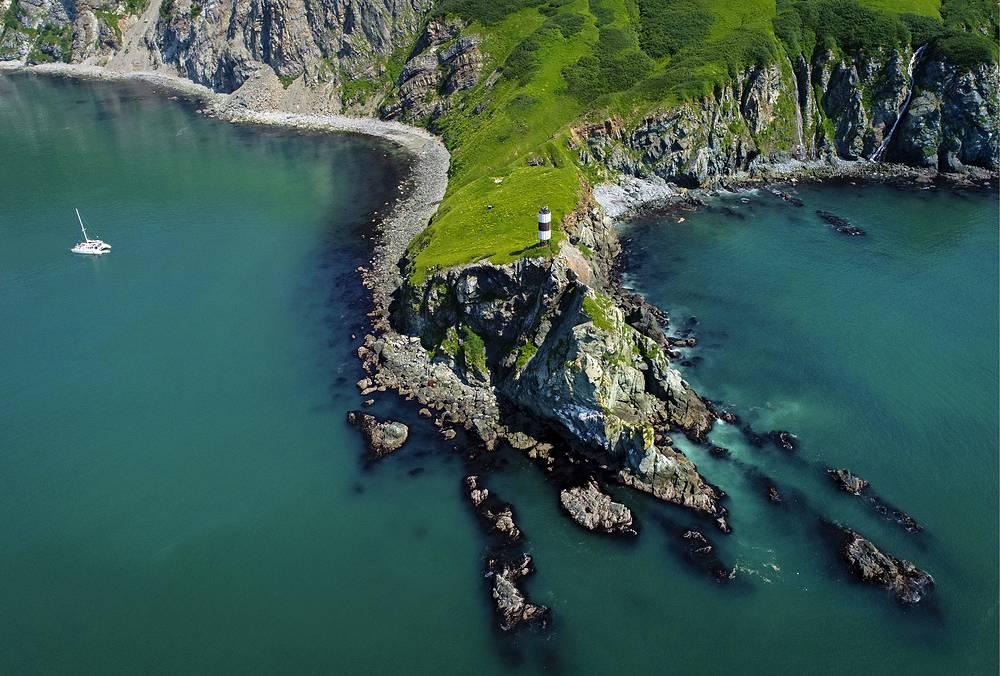 A lighthouse on Cape Green in Viluchinskaya bay on the southern coast of Kamchatka Peninsula
