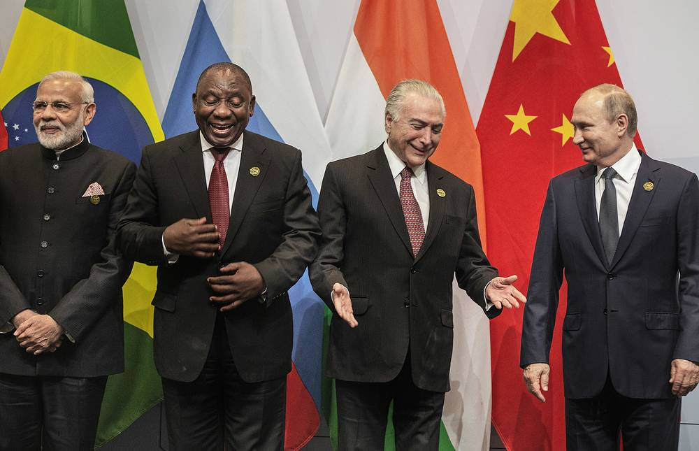 Indian Prime Minister Narendra Modi, South African President Cyril Ramaphosa, Brazil's President Michel Temer and Russia's President Vladimir Putin, get ready for a group photo at the BRICS Summit in Johannesburg, July 26