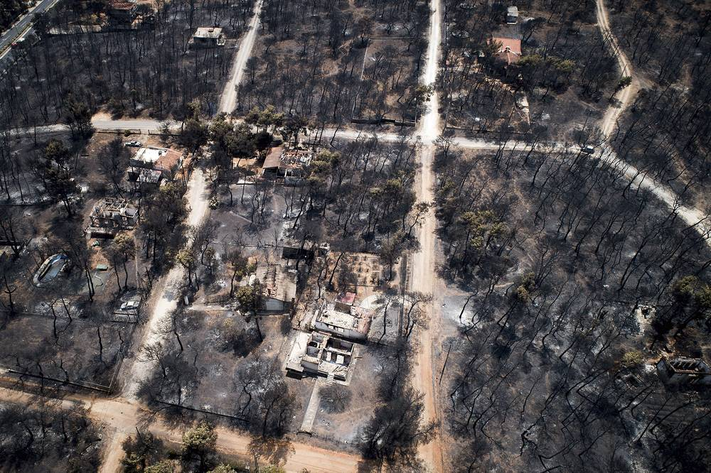 Houses and trees in Mati, east of Athens, reduced to smoldering ash following raging wildfires that swept through Greece, July 26