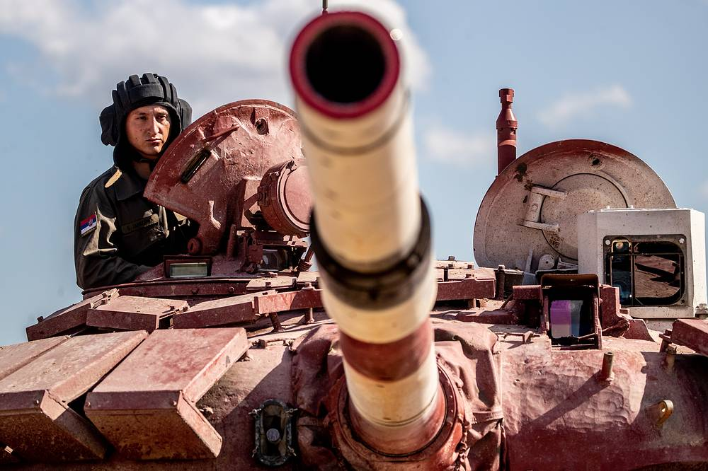 A member of the Serbian team waits to compete on a T-72B3 tank