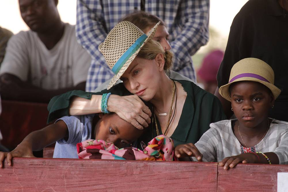 Madonna hugs her son Davidv and daughter Mercy in Malawi, 2014