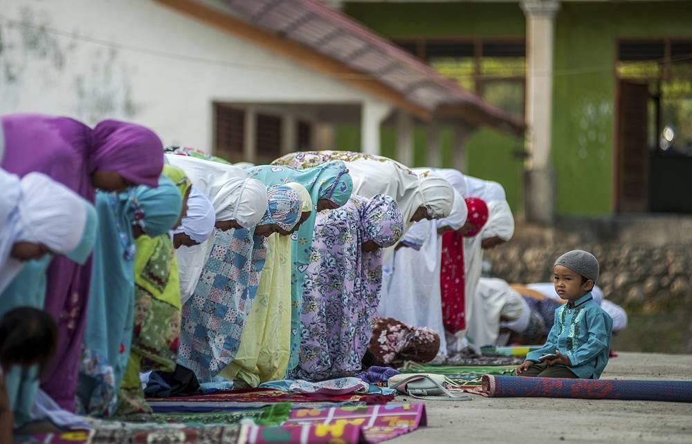 People attend a morning prayer marking Eid al-Adha in Kokokputek, Lombok Island, Indonesia