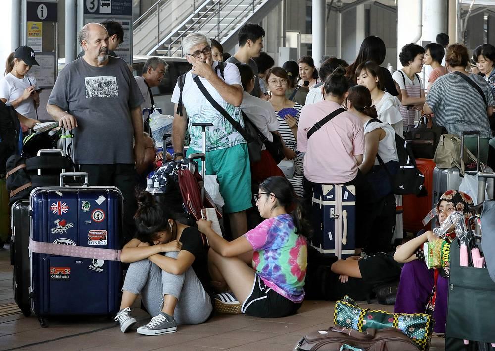 Passengers who stayed overnight waiting at Kansai International Airport in Izumisano, Japan