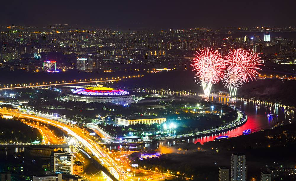 Fireworks bursting in the night sky over Moscow's Luzhniki Stadium