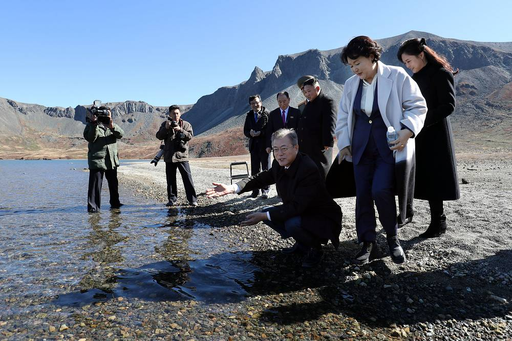 South Korean President Moon Jae-in collects water from heaven lake at the bottom of Mount Paektu during a visit with his North Korean counterpart Kim Jong-un in Mount Paektu, September 20