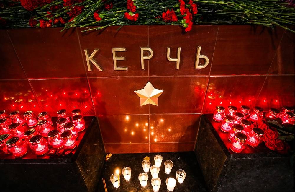 Flowers and candles left by mourners at the Great Patriotic War Hero City of Kerch monument in Moscow's Alexander Garden