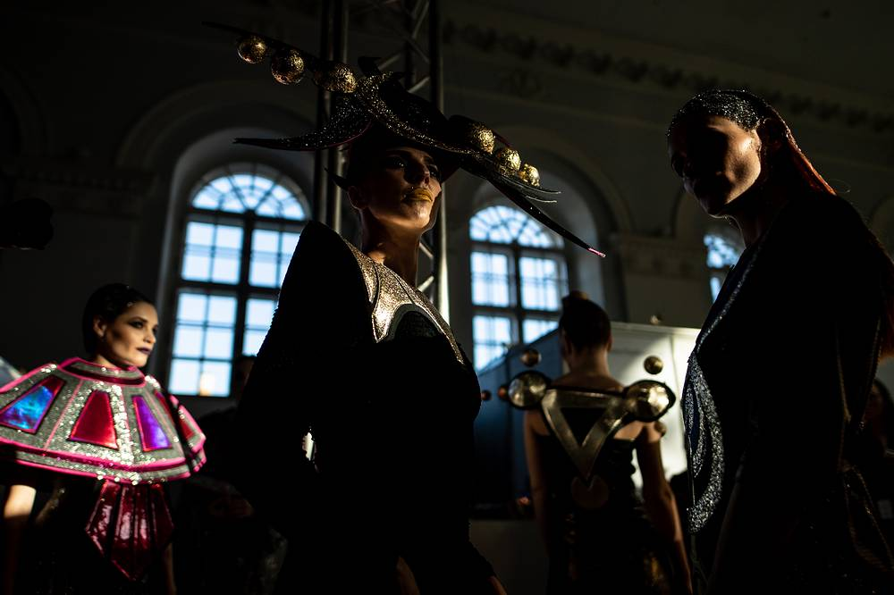 Models backstage before a catwalk show as part of the Mercedes-Benz Fashion Week Russia at the Manege Central Exhibition Hall in Moscow, October 16