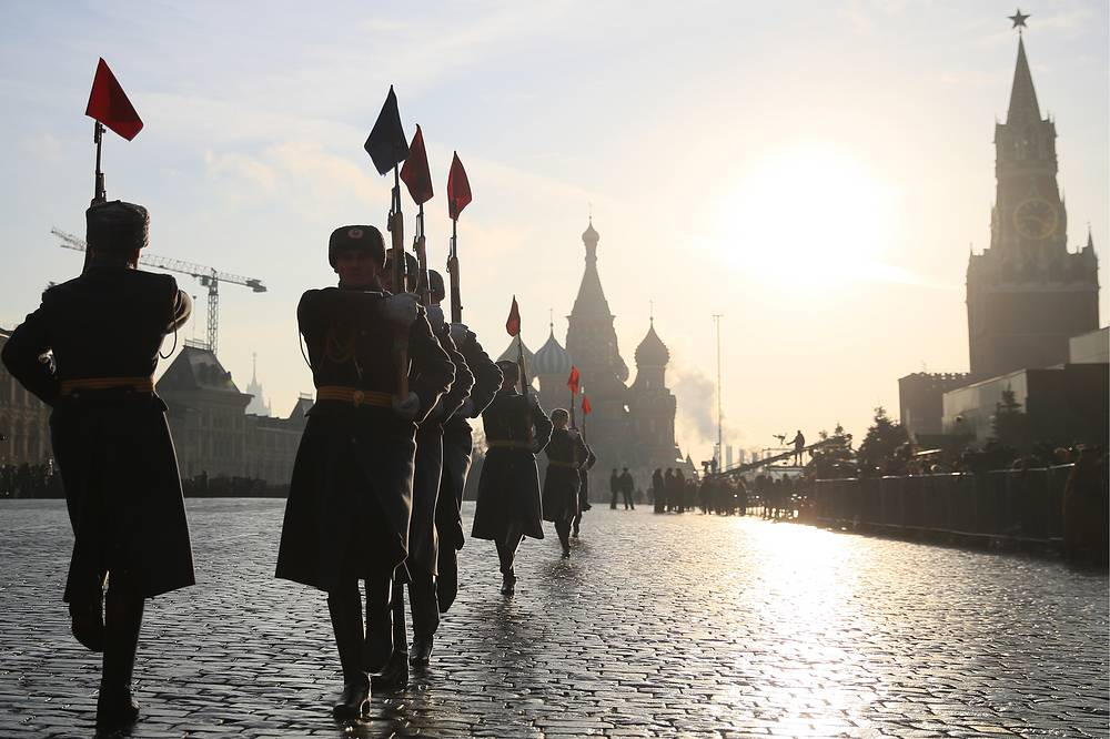 Russian servicemen dressed in historical uniform march during the parade