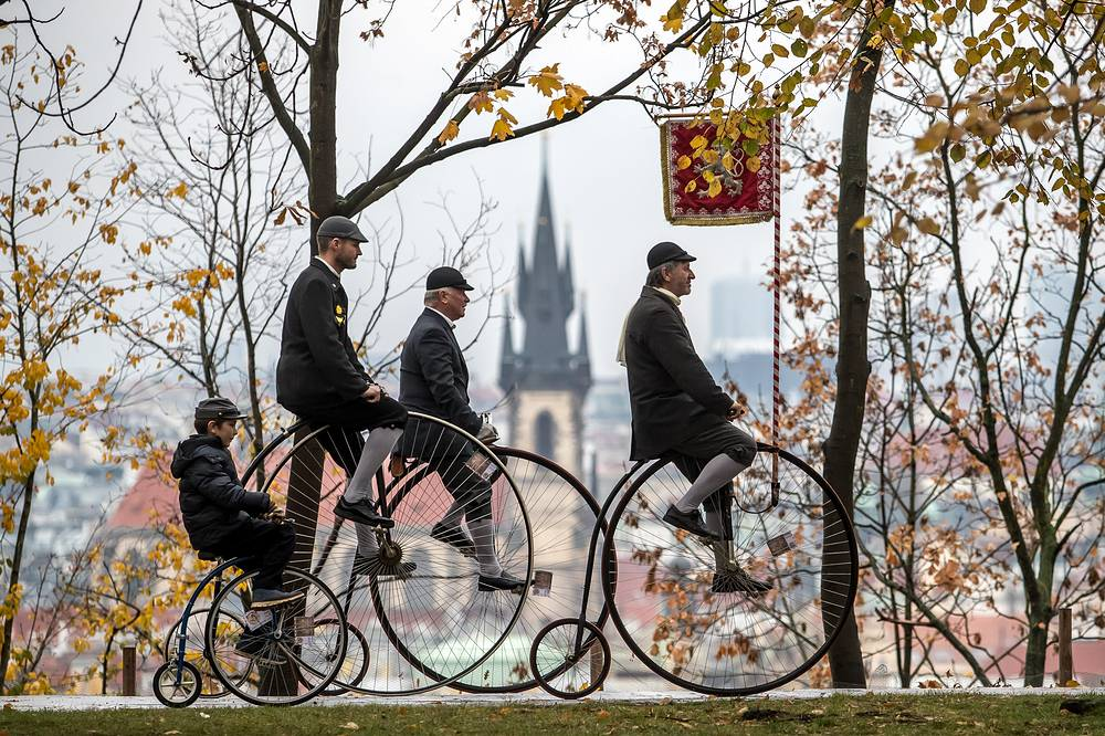 Participants wearing historical dress ride their high-wheels during the traditional 'Prague Mile' race, in Prague, November 3