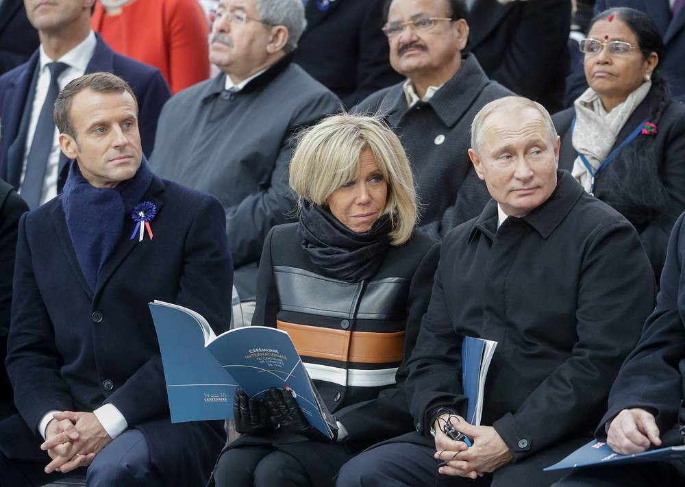 France's President Emmanuel Macron with wife Brigitte and Russia's President Vladimir Putin