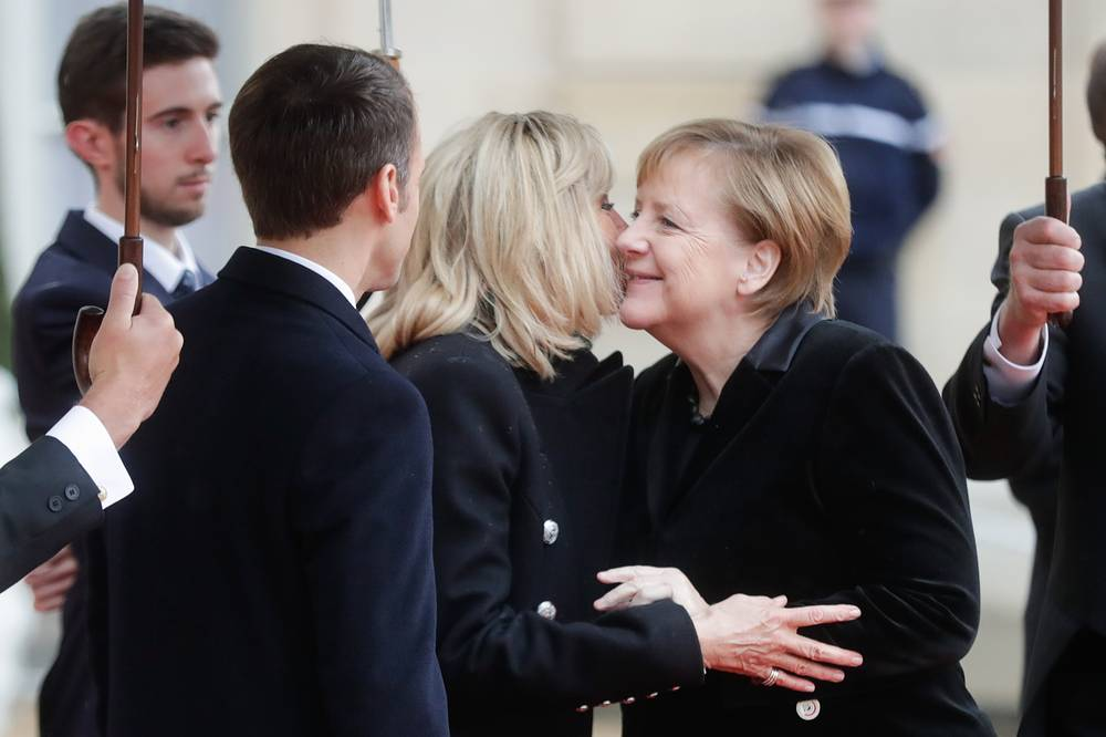 France's President Emmanuel Macron with wife Brigitte welcome Germany's Chancellor Angela Merkel