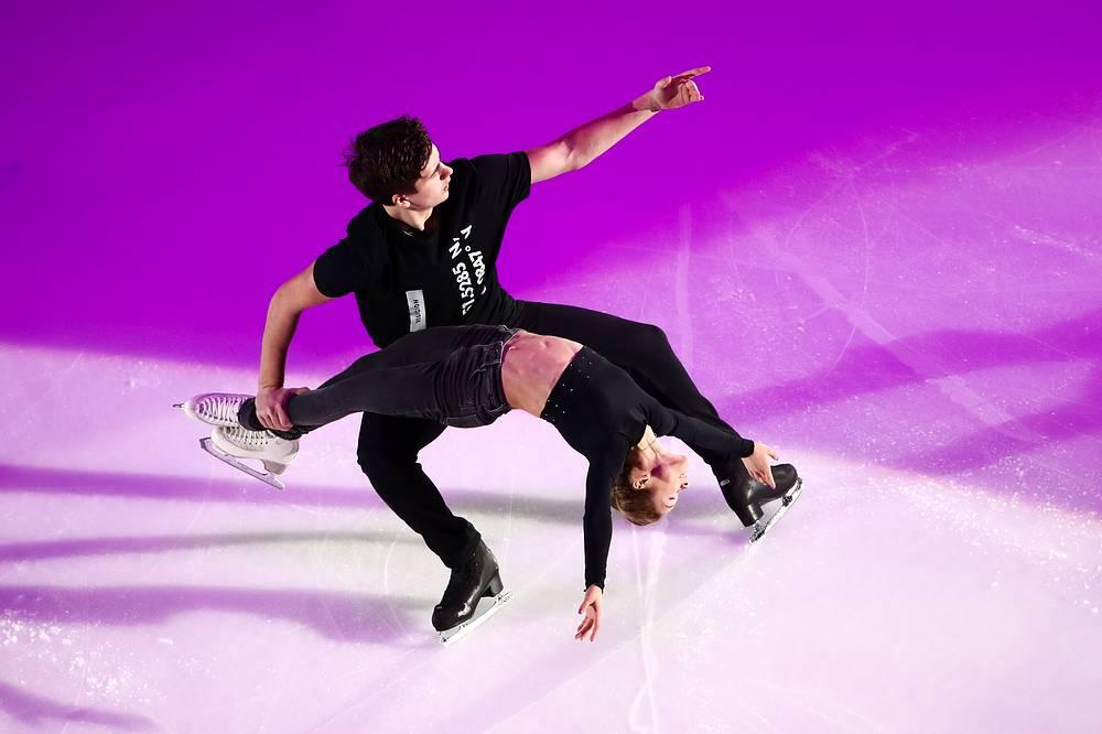 Bronze medalists in pair skating Darya Pavliuchenko and Denis Khodykin of Russia