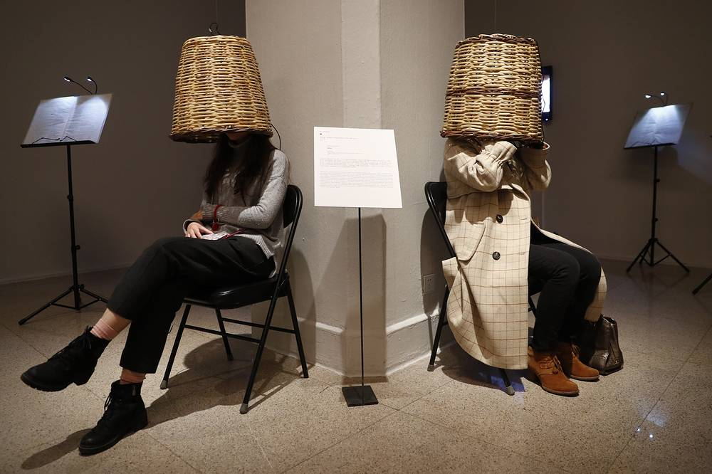 Visitors experience the installation 'Tettix' by Greek artist Phoebe Giannisi after the opening of the exhibition 'At the Beginning Was the Word. Concepts - Images - Script' at the National Art Museum of China in Beijing, November 27