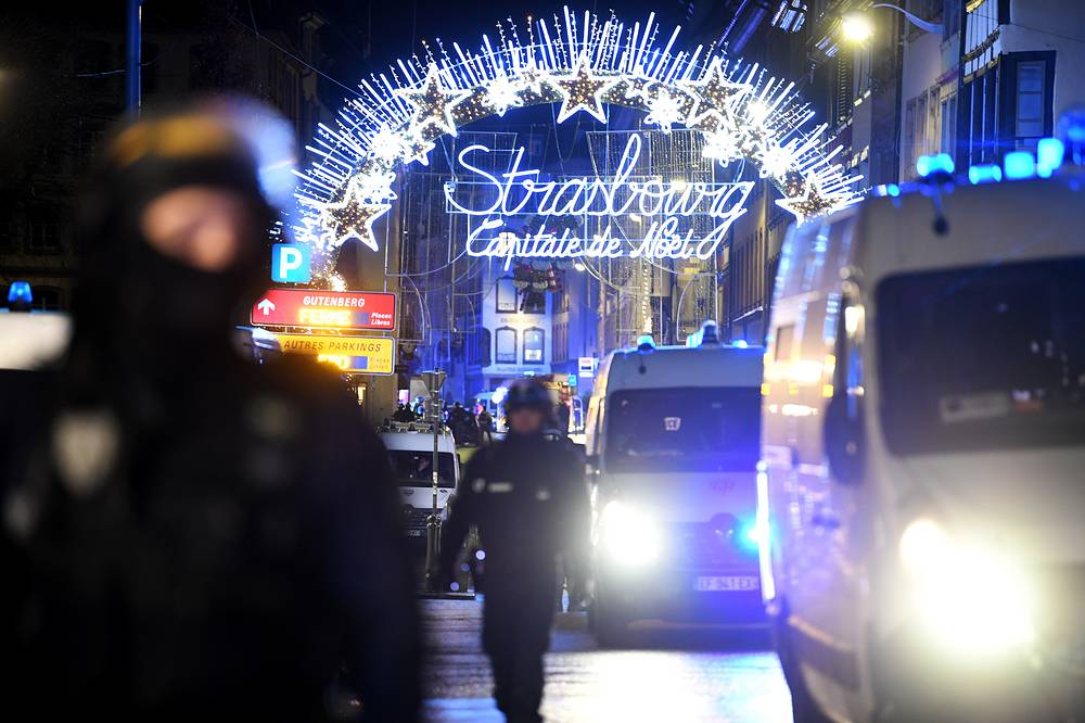 Police officers stand guard near the Christmas market where a deadly shooting took place in Strasbourg, December 11. According to the latest reports, four people were killed. The gunman is reported to have been killed in a shootout with police
