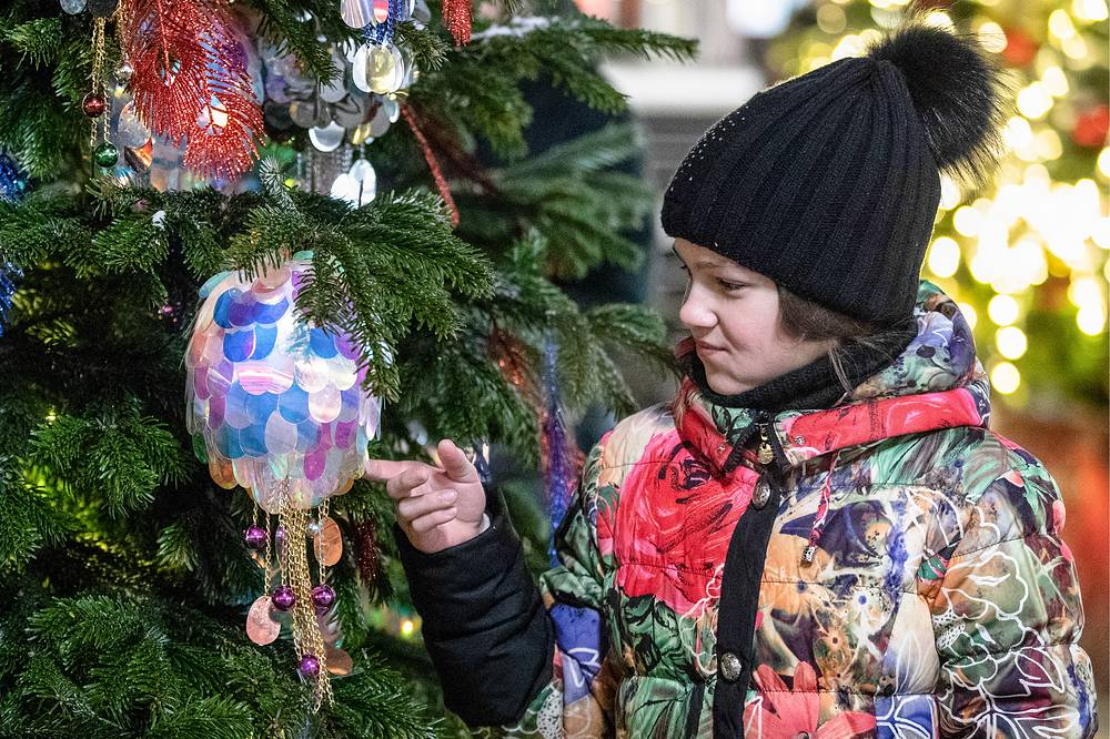 A girl looks at Christmas tree in Moscow's Manezhnaya Square