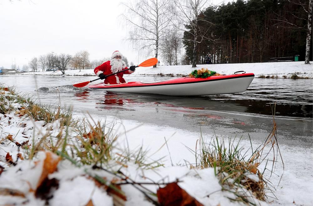 A man dressed as Santa Claus rowing along a lake during a Santa Run in Minsk, December 15