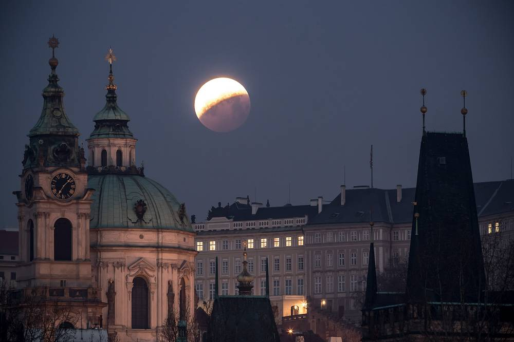 'Super Blood Wolf Moon' is seen over the Church of Saint Nicholas in Prague