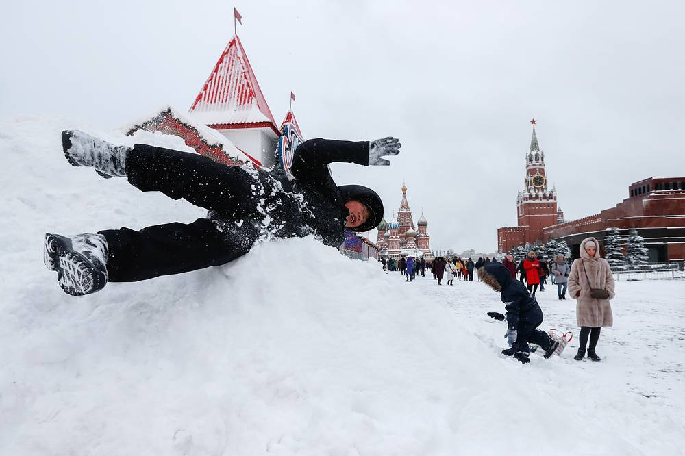 A child playing with snow in Moscow's Red Square
