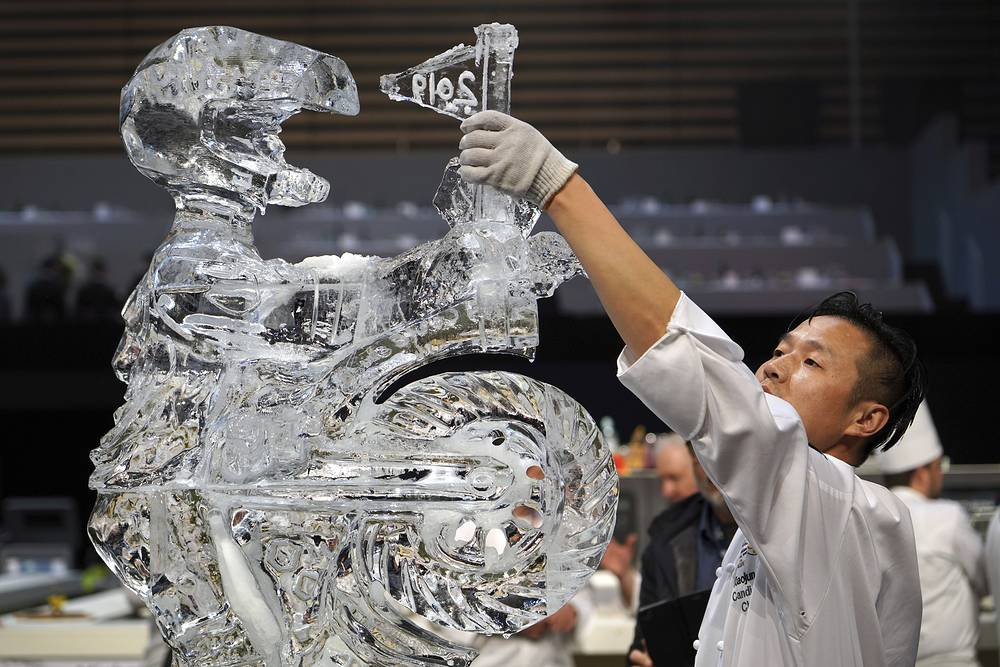 Xiaojun Li, member of the China team, works on a ice sculpture