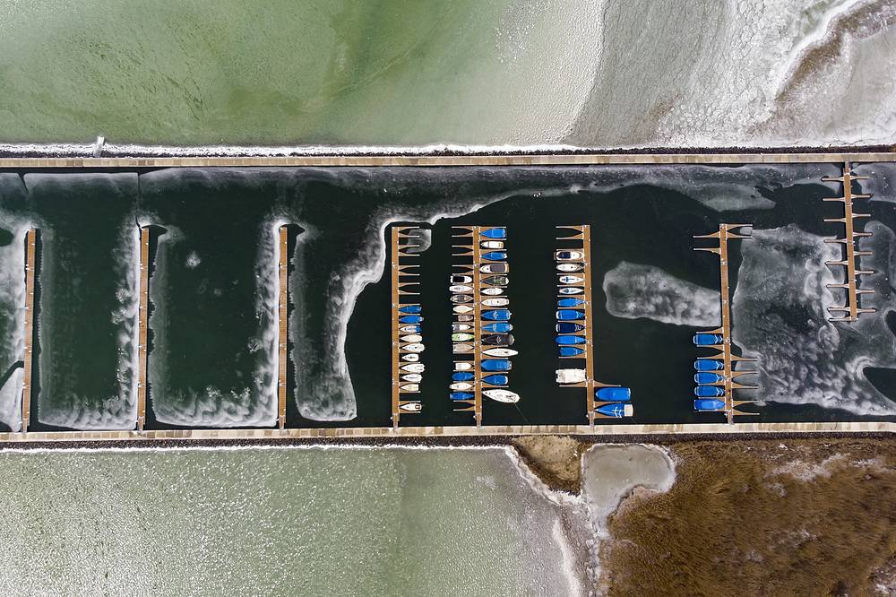 The yacht pier is enclosed with the icy water of Lake Balaton in Balatonfenyves, Hungary, January 29