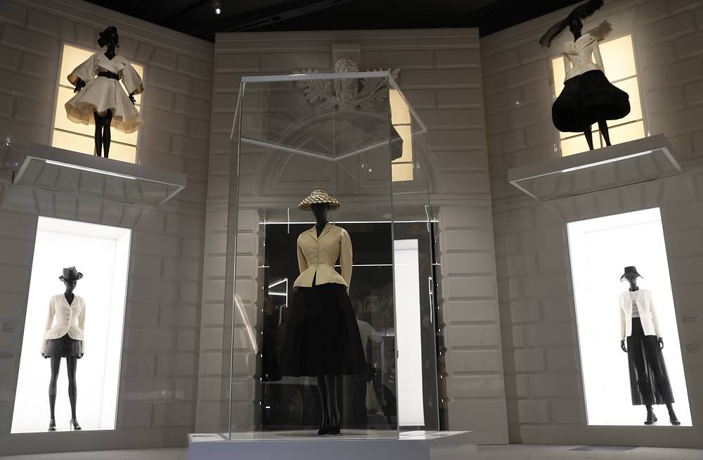 A Bar Suit and Hat made from silk, wool taffeta and straw, designed by Christian Dior, on display during a press preview of the Paris based fashion House of Dior at the V&A Museum in London, January 30
