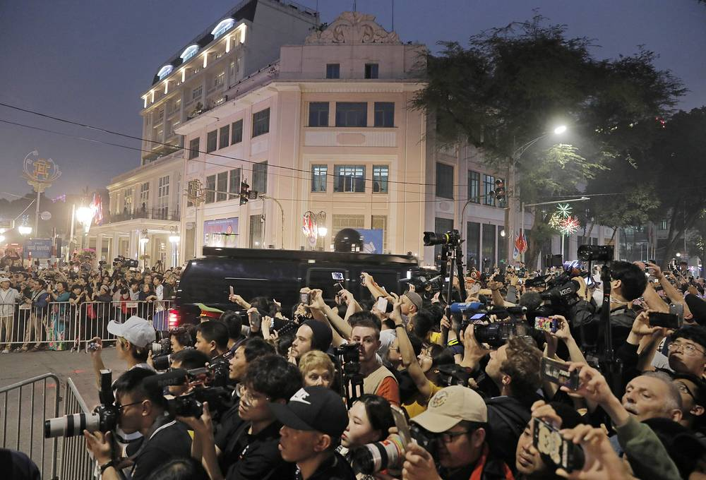 People gather outside Metropole Hotel where US, North Korea leaders are scheduled to have dinner in Hanoi