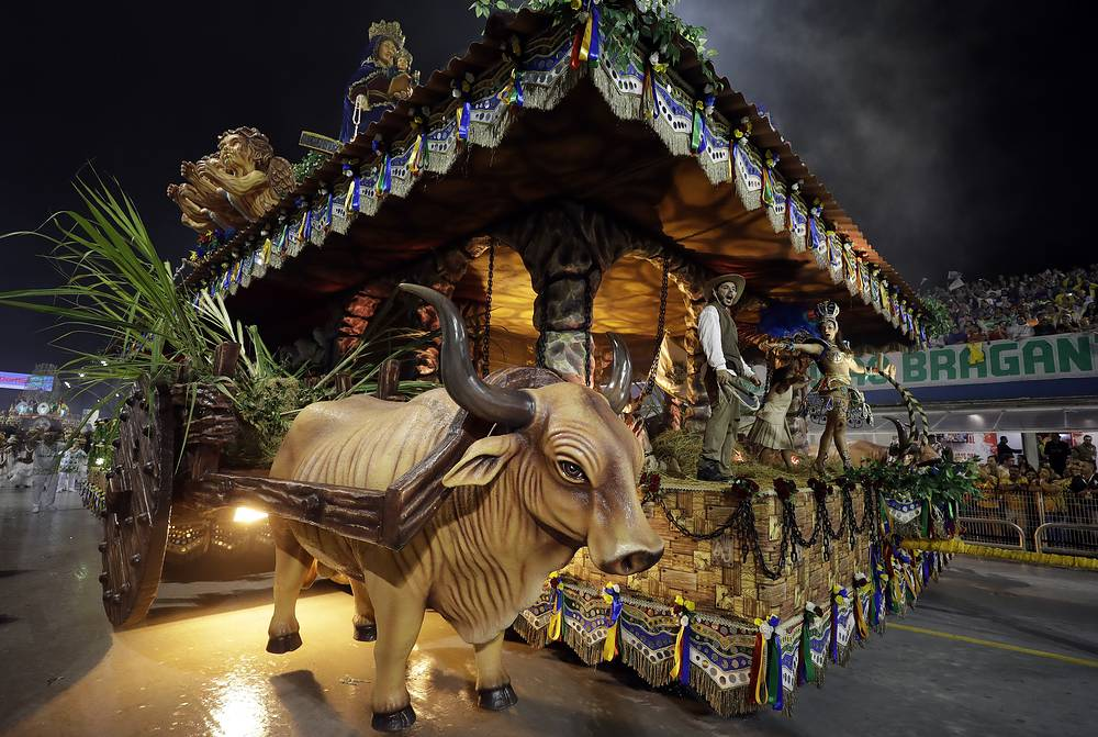 Dancers from the Mancha Verde samba school perform on a float during a carnival parade in Sao Paulo