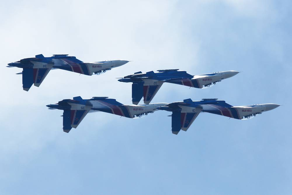 Sukhoi Su-30SM fighter aircraft of the Russkiye Vityazi [Russian Knights] aerobatic team perform at the Langkawi International Maritime and Aerospace Exhibition (LIMA 2019) on Malaysia's Langkawi Island.