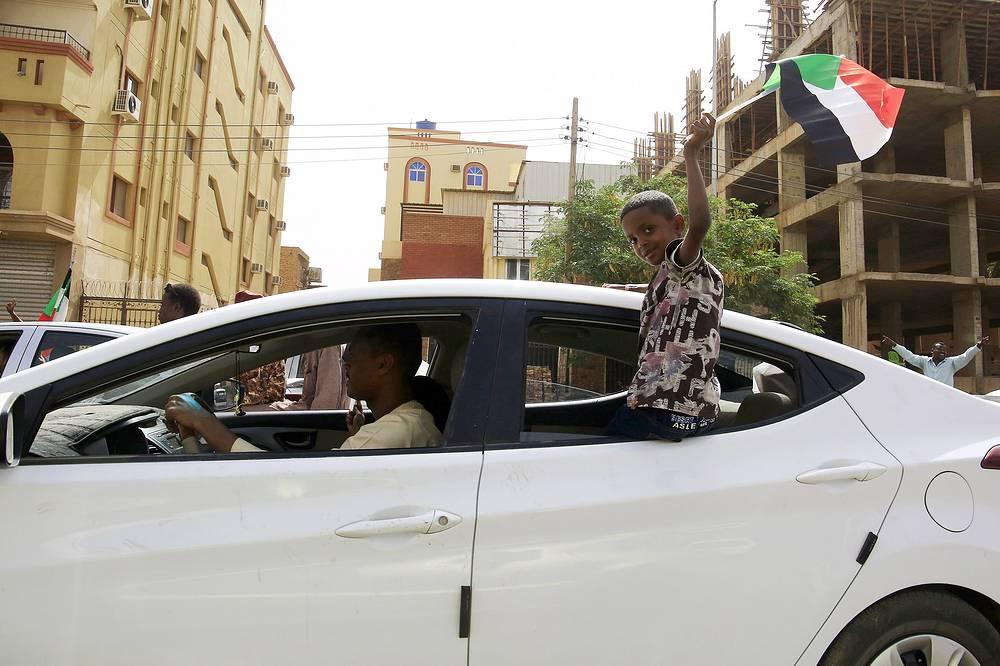 Sudanese people celebrating President Omar al-Bashir's ouster in Khartoum